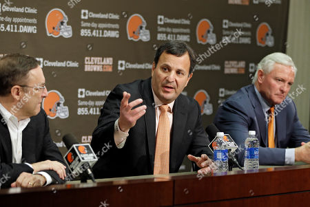 Mike Lombardi, Joe Banner, Jimmy Haslam Mike Lombardi, center, the Cleveland Browns vice president of player personnel, answers questions at during an NFL football news conference with CEO Joe Banner, left, and owner Jimmy Haslam at the team's practice facility in Berea, Ohio. The Browns fired their coach after one season. Now they're sweeping out their front office. Owner Jimmy Haslam announced, that Banner will step down in the next two months and general manager Michael Lombardi is leaving the team