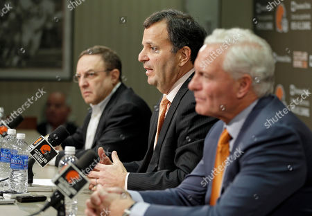 Mike Lombardi, Joe Banner, Jimmy Haslam Michael Lombardi, center, the Cleveland Browns' vice president of player personnel, answers questions during his introductory news conference at the NFL football team's practice facility in Berea, Ohio. Browns CEO Joe Banner, left, and owner Jimmy Haslam, right, listen. The Browns fired their coach after one season. Now they're sweeping out their front office. Owner Jimmy Haslam announced, that Banner will step down in the next two months and general manager Michael Lombardi is leaving the team