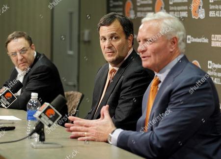 Mike Lombardi, Jimmy Haslam, Joe Banner Mike Lombardi, center, the Cleveland Browns' vice president of player personnel, listens as owner Jimmy Haslam, right, speaks during a press conference at the NFL football team's practice facility in Berea, Ohio, . Browns' CEO Joe Bannler looks, left