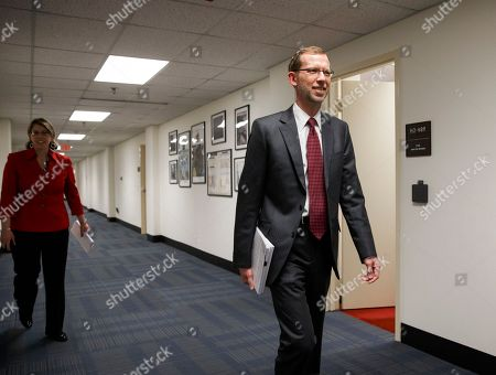 Douglas W. Elmendorf Congressional Budget Office Director Douglas W. Elmendorf walks through a corridor of the Ford House Office Building on Capitol Hill in Washington, before a briefing for reporters on the CBO's updated budget and economic outlook. The president's budget will be released next Monday