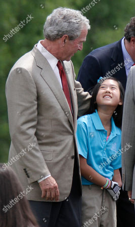 George W Bush Rebekah Walker, 11, is greeted by former President George W. Bush, left, at The First Tee of Little Rock Jack Stephens Youth Golf Academy in Little Rock, Ark