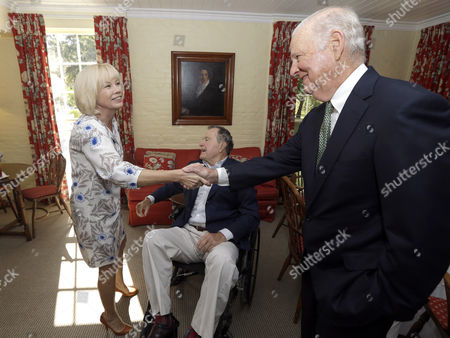 Stock Picture of Mikhail Gorbachev, George H.W. Bush Irina Virganskaya, daughter of former President of the Soviet Union Mikhail Gorbachev, left, is greeted by former Secretary of State James Baker, right, as former President George H.W. Bush, center, looks to greet Mikhail Gorbachev, in Houston. Gorbachev is in Houston to speak at the Brilliant Lecture Series