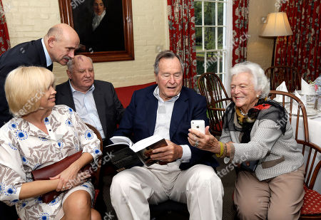 Mikhail Gorbachev, George H.W. Bush Former President of the Soviet Union Mikhail Gorbachev, back center, his daughter Irina Virganskaya, left, and adviser Pavel Palazhchenko, back left, visit with former President George H.W. Bush, center, and his wife Barbara, right, before having lunch, in Houston. Gorbachev is in Houston to speak at the Brilliant Lecture Series