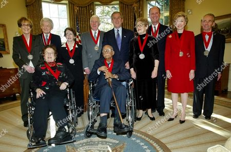 UPDIKE President Bush, center, poses with winners of the National Humanities Medal Awards during a ceremony in the Oval Office at the White House in Washington Friday morning, . With Bush are, standing from left to right: Elizabeth Fox-Genovese, humanities and women's studies professor; actor Hal Holbrook; author Prof. Edith Kurzweil; author John Updike; Midge Decter; author, essayist and social critic; Dr. Robert Ballard, marine scientist who found the Titanic; Joan Ganz Cooney, creator of Sesame Street and Joseph Epstein, professor and essayist. Bottom row, authors Jean Fritz and Frank Snowden