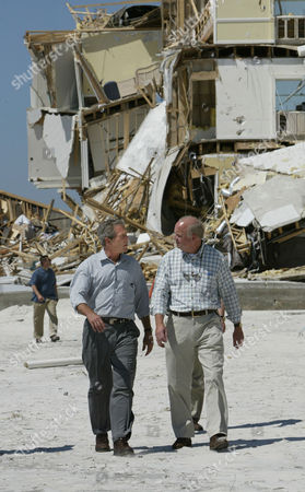 BUSH BONNER President Bush, left, talks with Rep. Jo Bonner, R-Ala., as he walks on Perdido Beach while touring damage from Hurricane Ivan in Orange Beach, Ala