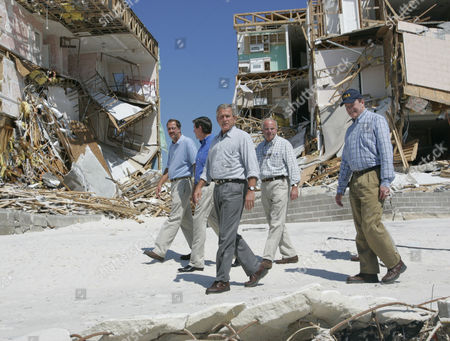 BUSH President Bush, center, walks along Perdido Beach with, from left to right, Mayor Steve Russo, Alabama Gov. Bob Riley, Rep. Jo Bonner, R-Ala., and Sen. Richard Shelby, R-Ala., as he tours damage from Hurricane Ivan in Orange Beach, Ala