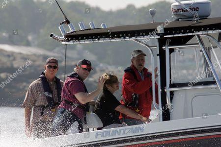 """George Herbert Walker Bush Former President George Herbert Walker Bush, far right, on his boat """"Fidelity"""" in the waters of the Atlantic Ocean off Kennebunkport, Maine"""