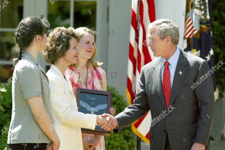 BUSH Sandra Swanson shakes hands with President Bush after she received the Medal of Honor, which was presented posthumously to her husband Army Capt. Jon E. Swanson, a Vietnam soldier, in the Rose Garden of the White House, Wednesday, May, 1, 2002. Swanson's daughters Brigid Swanson Jones, left, and Holly Walker, right, also attened the ceremony