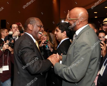 Herman Cain Republican presidential candidate Herman Cain, left, greets Lance Robertson, right, of Atlanta after speaking to The Federation of Young Republican Broad
