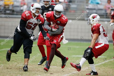 Jaron Brown, Edwin Jackson, LaMarr Woodley Arizona Cardinals' Jaron Brown (13) runs out of room on a reverse as defenders LaMarr Woodley (52) and Edwin Jackson (58) close in for the tackle during an NFL football training camp practice, in Glendale, Ariz