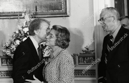 President Jimmy Carter embraces Patricia Harris, his new Housing and Urban Development secretary, during a reception at the White House, in Washington. The president has planned a series of parties for campaign workers, government officials and diplomats
