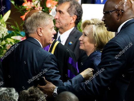 Hillary Rodham, Nikki Haley Republican presidential candidate Sen. Lindsey Graham, R-S.C., left, talks with Democratic presidential candidate Hillary Rodham Clinton, right, at the funeral service for Rev. Clementa Pinckney, in Charleston, S.C