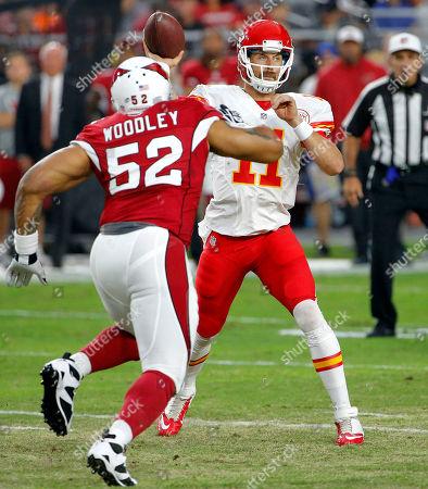 Alex Smith, LaMarr Woodley Kansas City Chiefs quarterback Alex Smith (11) throws under pressure from Arizona Cardinals linebacker LaMarr Woodley (52) during the first half of an NFL preseason football game, in Glendale, Ariz