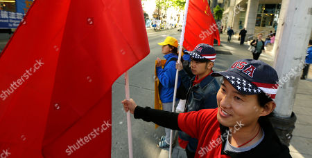 Stock Picture of Joe Chen Joe Chen, right, who is from China but lives and works in Seattle, wears a USA ball cap and holds a Chinese flag as he stands near the hotel where Chinese President Xi Jinping is staying, in Seattle. Chen said he just wanted to welcome the president to Seattle and let him know that people are glad he is here. Xi was in Seattle on his way to Washington, D.C., for a White House state dinner on Friday