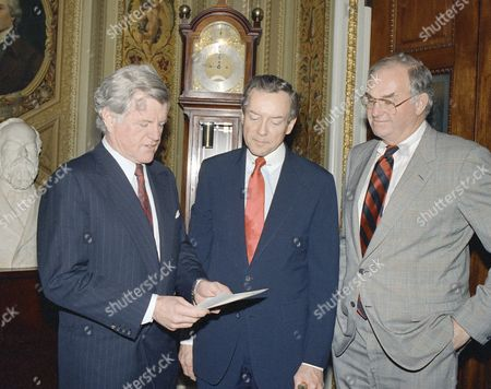 Sen. Edward Kennedy, Mass., left, Orin Hatch, R-Utah, center, and Sen. Lowell Weicker, R-Conn., look over vote some notes on Capitol Hill, Washington on after the senate voted 73-24 to override President Ronald Reagan's vote of the Civil rights Restoration Act. The house followed suit later in the day on a vote of 292-133
