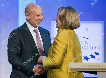 "Lloyd Blankfein, Hillary Rodham Clinton Lloyd Blankfein, left, Chairman and CEO of Goldman Sachs, is greeted by Hillary Rodham Clinton, former Secretary of State, for a panel discussion, ""Equality for Girls and Women: 2034 Instead of 2134?"" at the Clinton Global Initiative, in New York"