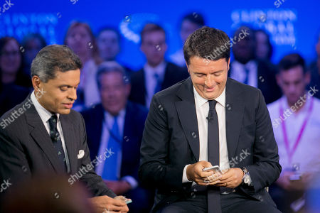 Former President Bill Clinton Italian Prime Minister Matteo Renzi George Soros, Chairman of Soros Fund Management CNN correspondent Fareed Zakaria, left, and Italian Prime Minister Matteo Renzi turn off their cell phones prior to a television interview for CNN, at the Clinton Global Initiative in New York