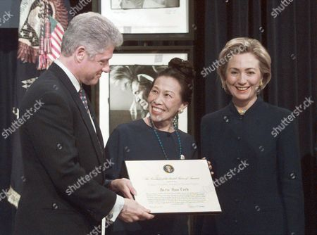Stock Picture of CLINTON LORD CLINTON President Clinton presents the newly created Eleanor Roosevelt Award for Human Rights to Bette Bao Lord, a China-born human rights activist, scholar and novelist, as first lady Hillary Rodham Clinton looks, during a White House ceremony commemorating the 50th Anniversary of the Declaration of Human Rights, in Washington
