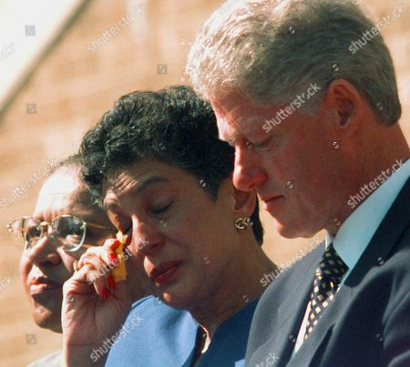 CLINTON KARLMARK LANIER Carlotta Walls LaNier, a member of the Little Rock Nine, wipes tears from her eyes as she listens to a speech by fellow member Ernest Green at the 40th anniversary of the integration of Little Rock Central High School. Standing with her on the steps of the school in Little Rock, Ark., are President Clinton and Little Rock Nine member Gloria Ray Karlmark at left