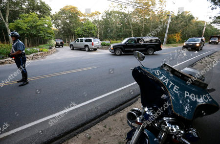 Vehicles form part of a motorcade, behind, transporting President Barack Obama, as they arrive at Farm Neck Golf Club, in Oak Bluffs, Mass., on the island of Martha's Vineyard. Vernon Jordan, whose birthday party is scheduled for Saturday evening at the golf club, has President Obama, former President Bill Clinton, and Democratic presidential front-runner Hillary Rodham Clinton on the guest list