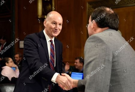 Mike Lee, Mark Hunter Molson Coors President and Chief Executive Officer Mark Hunter, left, shakes hands with Senate Antitrust, Competition Policy and Consumer Rights Subcommittee chairman Sen. Mike Lee, R-Utah, right, on Capitol Hill in Washington, before the start of a hearing on the proposed $107 billion takeover by the world's largest brewer, Anheuser Busch InBev, of rival SABMiller. The combined company would control nearly a third of the global beer market