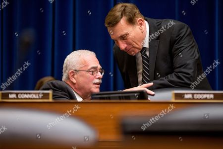 Rep. Gerald Connolly, D-Va., left, speaks with Rep. John Mica, R-Fla., right, on Capitol Hill in Washington, during the House Oversight and Government Reform Committee hearing on the economic impact of regulating drone technology for personal and commercial uses as well as privacy concerns on the economic impact of regulating drone technology for personal and commercial uses as well as privacy concerns