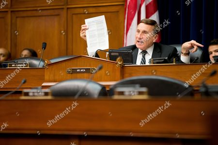 Rep. John Mica, R-Fla. holds up a documents while asking for concrete deadlines from the Federal Aviation Administration on drone regulations on Capitol Hill in Washington, during the House Oversight and Government Reform Committee hearing on the economic impact of regulating drone technology for personal and commercial uses as well as privacy concerns on the economic impact of regulating drone technology for personal and commercial uses as well as privacy concerns