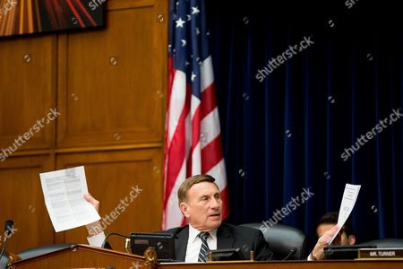 Rep. John Mica, R-Fla. holds up documents while asking for concrete deadlines from the Federal Aviation Administration on drone regulations on Capitol Hill in Washington, during the House Oversight and Government Reform Committee hearing on the economic impact of regulating drone technology for personal and commercial uses as well as privacy concerns on the economic impact of regulating drone technology for personal and commercial uses as well as privacy concerns