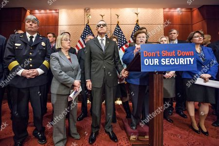 """Mike Kelley, Harry Reid, Barbara Mikulski, Patty Murray, Amy Klobuchar Democratic senators are joined by first responders at an event on Capitol Hill to urge Republicans to support a """"clean bill"""" to fund the Department of Homeland Security as that agencies budget expires later this week, in Washington, . In front row, from left are Fire Chief Mike Kelley of the Sandy Spring, Md., Volunteer Fire Department, Sen. Patty Murray, D-Wash., Senate Minority Leader Harry Reid, D-Nev., Sen. Barbara Mikulski, D-Md., and Sen. Amy Klobuchar, D-Minn"""