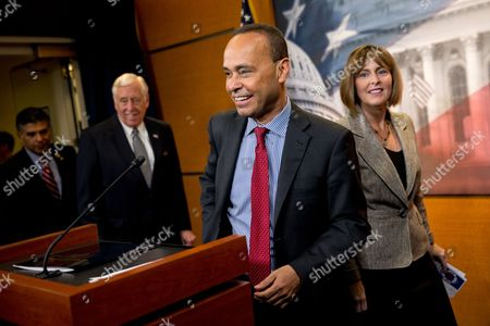 "Steny Hoyer, Luis Gutierrez, Kathy Castor Rep. Luis Gutierrez, D-Ill., center, accompanied by House Minority Whip Steny Hoyer of Md., left, and Rep. Kathy Castor, D-Fla., arrive for a news conference on Capitol Hill in Washington, to talk about the ""continuation of efforts to educate individuals and families about the president's immigration executive actions"