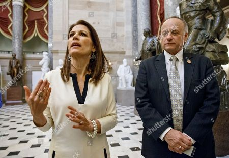 Michele Bachmann, Steve King Rep. Michele Bachmann, R-Minn., left, and Rep. Steve King, R-Iowa, vocal conservatives in the GOP challenge to President Obama's immigration order, speak with reporters at the Capitol as the House Republican leadership works to muster votes for final passage of the omnibus spending bill to fund the government, in Washington, . Earlier in the day, conservatives sought to torpedo the measure because it would leave Obama's immigration policy unchallenged, but Speaker John Boehner patrolled the noisy, crowded House floor looking for enough GOP converts to keep it afloat