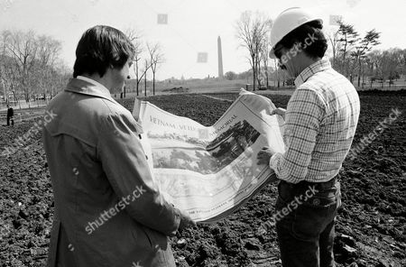 Jan Scruggs Jan Scruggs, left, president of the Vietnam Veterans Memorial Fund and Gary Wright the project engineer for the memorial look over plans for the project in Washington, which will be built on this site near the Washington Monument. Groundbreaking will be on March 26