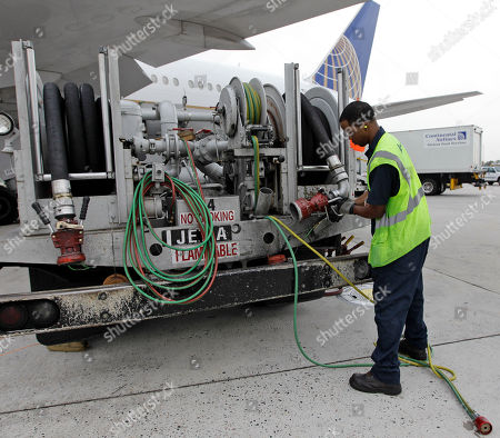 Continental Airlines fuel Louis Williams returns a hose to a fueling truck after fueling a Continental Airlines plane at George Bush Intercontinental Airport in Houston. Continental is part of the global Star Alliance network