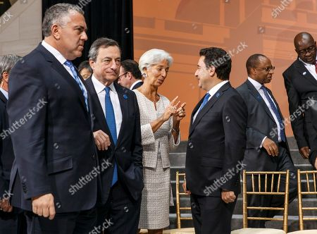 Joe Hockey, Christian Noyer, Christine Lagarde, Ali Babacan, Daniel Mminele, Nhlanhla Nene From left, Australia's Treasurer Joe Hockey, chair of the Group of Twenty, walks with Mario Draghi, president, European Central Bank, as International Monetary Fund Managing Director Christine Lagarde, center, speaks with Ali Babacan, Turkey's deputy prime minister for the economy, as the G-20 gathers for the IMF and World Bank meetings in Washington, . Second from right, South African Reserve Bank Daniel Mminele, speaks with South Africa Mninister of Finance Nhlanhla Nene, far right