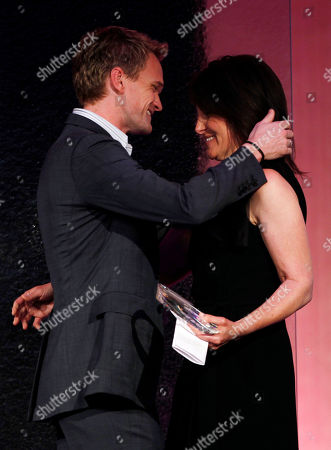 Pamela Fryman, Neil Patrick Harris Director Pamela Fryman, right, accepts the Dorothy Arzner Directors award from actor Neil Patrick Harris at the 2011 Crystal and Lucy Awards in Beverly Hills, Calif., . The Crystal and Lucy awards is a gala fundraising dinner in support of Women in Film, Los Angeles