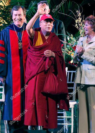 Dalai Lama, Linda Hart, R. Gerald Turner The Dalai Lama, center, waves before he received an honorary degree at SMU in Dallas, . The Dalai Lama was on hand for special lecture as part of 10th Hart Global Leader Forum at the university. Linda Hart is at right and SMU President R. Gerald Turner is left