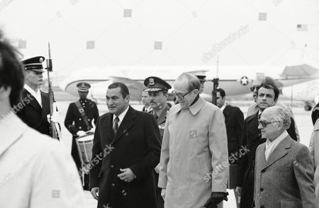 Hosni Mubarak, David Newsom U.S. Assistant Secretary of State for Political Affairs David Newsom, right, escorts Egyptian Vice President Hosni Mubarak, left, from his plane on his arrival at Andrews Air Force Base outside Washington, . Mubarak is visiting Washington to carry a message of gratitude from Egypt's President Anwar Sadat to President Carter for his Middle East peace efforts and to pursue some of the unfinished business between the United States and Egypt