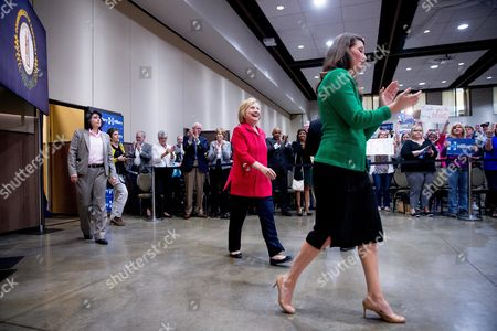 Hillary Clinton, Alison Lundergan Grimes Democratic presidential candidate Hillary Clinton, center, accompanied by Kentucky Secretary of State Alison Lundergan Grimes, right, speaks at a get out the vote event at James E. Bruce Convention Center in Hopkinsville, Ky