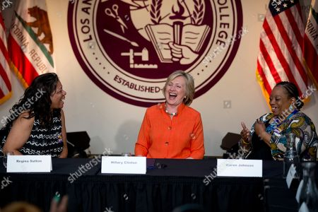 Hillary Rodham Clinton, Regina Sutton, Karen Johnson Democratic presidential candidate Hillary Rodham Clinton, center, shares a laugh with home care worker Regina Sutton, left, and home care consumer Karen Johnson, right, during a roundtable discussion on home care, in Los Angeles