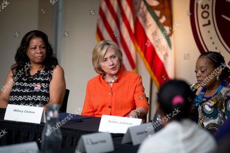 Stock Picture of Hillary Rodham Clinton, Regina Sutton, Karen Johnson Democratic presidential candidate Hillary Rodham Clinton, center, speaks as she is joined by home care worker Regina Sutton, left, and home care consumer Karen Johnson, right, during a roundtable discussion on home care, in Los Angeles