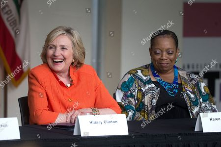 Hillary Rodham Clinton Democratic presidential candidate Hillary Rodham Clinton, left, laughs as she is joined by home care recipient Karen Johnson during a roundtable discussion on home care, in Los Angeles