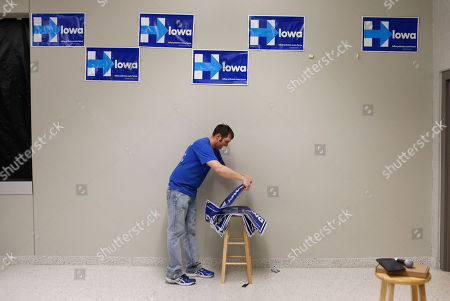 Shawn Stender Shawn Stender removes campaign signs for Democratic presidential candidate Hillary Clinton after a town hall featuring Clinton at Vernon Middle School in Marion, Iowa