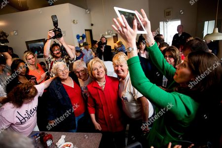 Hillary Clinton, Alison Lundergan Grimes Democratic presidential candidate Hillary Clinton poses for a photograph taken by Kentucky Secretary of State Alison Lundergan Grimes, right, as she greets patrons at the Lone Oak Little Castle Restaurant in Paducah, Ky