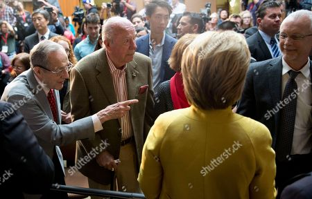 Hillary Clinton, George Shultz, William Perry, David Perry Former Defense Secretary William Perry, left, introduces Democratic presidential candidate Hillary Clinton to his son David Perry, right, as former Secretary of State George Shultz stands second from left, after Clinton spoke about counterterrorism, at the Bechtel Conference Center at Stanford University in Stanford, Calif