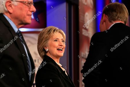 Democratic presidential candidate, Hillary Rodham Clinton, talks to moderator John Dickerson before a Democratic presidential primary debate, in Des Moines, Iowa