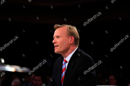 Moderator John Dickerson ask a question during a Democratic presidential primary debate, in Des Moines, Iowa