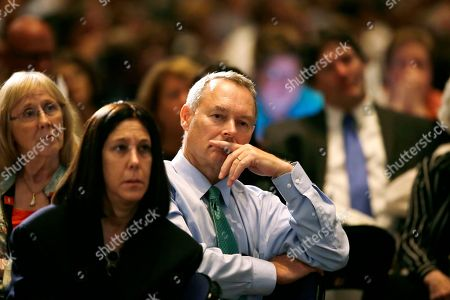 Michael Fitzgerald State Treasurer of Iowa Michael Fitzgerald, center, listens to a speaker during the Iowa Democratic Party's Hall of Fame Dinner, in Cedar Rapids, Iowa