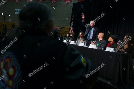Bernie Sanders Democratic presidential candidate Sen. Bernie Sanders, I-Vt., waves to leave as activist Clyde Bellecourt, co-founder of the American Indian movement, asks a question during a forum on race and economic opportunity at Patrick Henry High School,, in Minneapolis, Minn