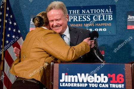 Jim Webb, Karrie Boswell Former Virginia Sen. Jim Webb gets a hug from a supporter from the audience, Karrie Boswell with Fairfax County Fire and Rescue, left, as he announces he will drop out of the Democratic race for president, during a news conference at the National Press Club in Washington