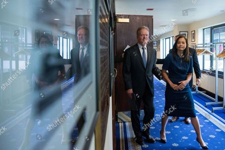 Jim Webb, Hong Le Webb Former Virginia Sen. Jim Webb, accompanied by his wife Hong Le Webb, right, arrives for a news conference to announce he will drop out of the Democratic race for president, at the National Press Club in Washington